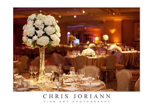 and the ivory floral centerpieces were set on vases with floating candle